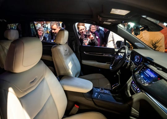 People get a close look at the Cadillac XT6 during its reveal event at GM's Spring Hill plant Thursday, January 24, 2019.
