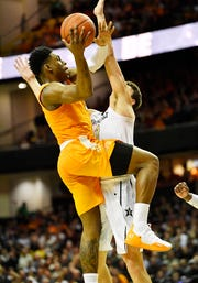 UT guard Admiral Schofield (5) is fouled on the way to the basket by Vanderbilt forward Yanni Wetzell (1) during the second half at Memorial Gym in Nashville, Tenn., Wednesday, Jan. 23, 2019.