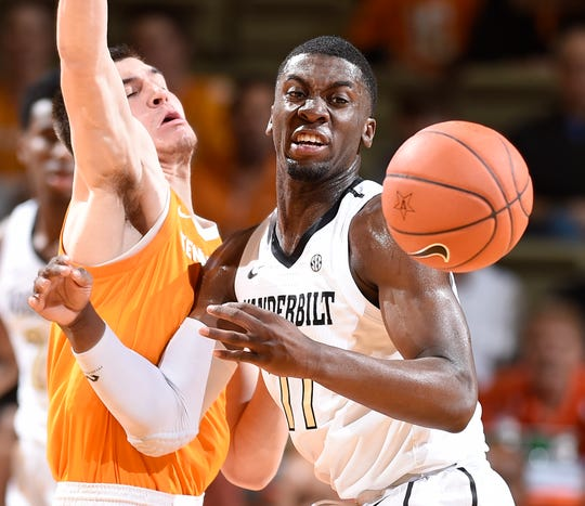UT forward John Fulkerson (10) and Vanderbilt forward Simisola Shittu (11) go after a ball during the first half at Memorial Gym in Nashville, Tenn., Wednesday, Jan. 23, 2019.