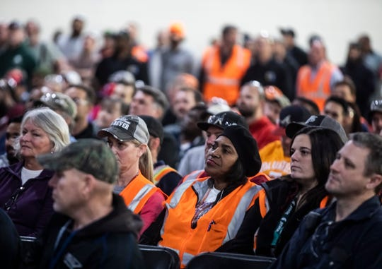 GM employees attend the reveal event for the Cadillac XT6 at GM's Spring Hill plant Jan. 24, 2019. The UAW announced a national strike against GM will begin at midnight Sunday.