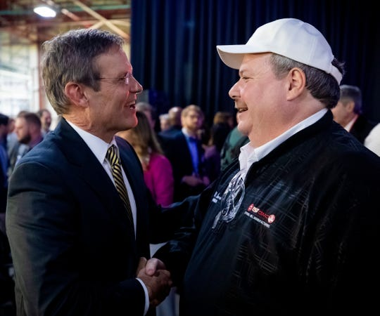Governor Bill Lee, left, greets Mike Herron, Chairman of UAW Local 1853, during the reveal event for the Cadillac XT6 at GM's Spring Hill plant Thursday, January 24, 2019.