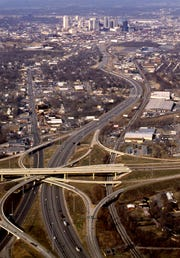 The Interstate 65/440 Parkway junction rises up before a distant downtown Nashville on Jan. 6, 1989.