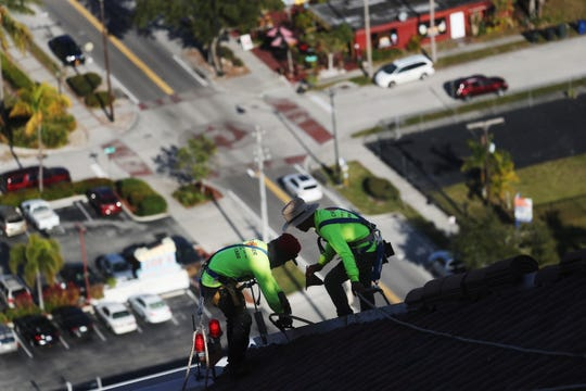 The roof of High Point Place in downtown Fort Myers is being replaced after it was damaged by Hurricane Irma in 2017. The tallest of five buildings stand at 32 stories high and are the tallest buildings between Miami and Tampa. The roof on all the buildings are being replaced by Crowther Roofing.