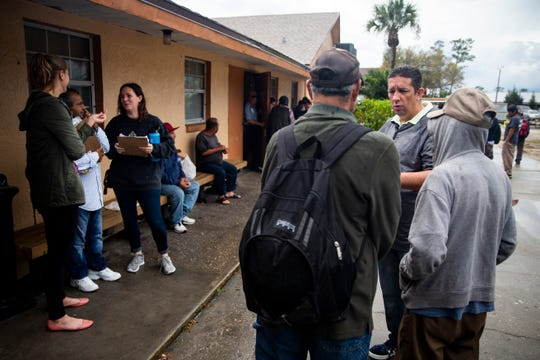 Fabricio Ferrer, case manager with the David Lawrence Center, right, helps people fill out surveys during the annual point-in-time homeless count conducted by the Hunger and Homeless Coalition of Collier County at Guadalupe Social Services in Immokalee on Thursday, Jan. 24, 2019.