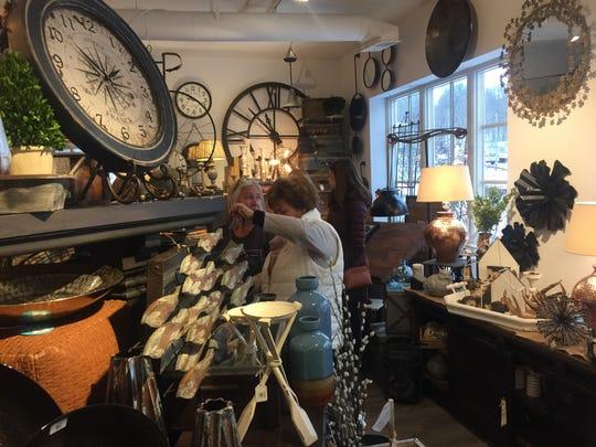 "Visitors explore the offerings in ""Cedar & Thread"" on Jan. 24."