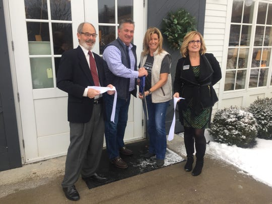 Steve Matheny of the Granville Area Chamber of Commerce, Kraig and Michele Koester, and Jennifer McDonald of the Licking County Chamber of Commerce officially mark the Koesters' re-branded Cedar and Thread with a ribbon cutting Jan. 24.