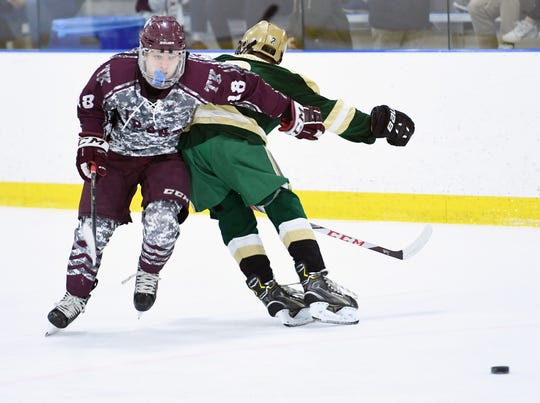 Don Bosco vs. St. Joe's in the Bergen County ice hockey final at the Ice Vault in Wayne on Wednesday, January 23, 2019. DB #18 Connor Sedlak tries to get past SJ #2 Ricky Demario in the second period.