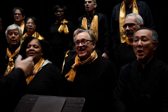 (from left, bottom row) Gail Smith, Jack Aaker, and Wesley Matsui rehearse with the Teaneck Community Chorus on Sunday, Jan. 20, 2019 at Teaneck High School. The chorus is celebrating their 20th anniversary this year.