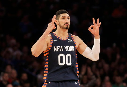 New York Knicks' Enes Kanter reacts after scoring during the first half of the NBA basketball game against the Milwaukee Bucks, Tuesday, Dec. 25, 2018, in New York.