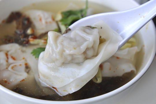 Dumplings in soup at Soup Dumplings Pljus