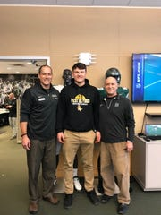 Zack Milko, middle, paid an official visit to Dartmouth last weekend and spent time with offensive coordinator/quarterback coach Kevin Daft, left, and defensive coordinator Don Dobes.