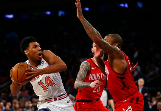 New York Knicks guard Allonzo Trier (14) goes to the basket against Houston Rockets defenders during the second half at Madison Square Garden.