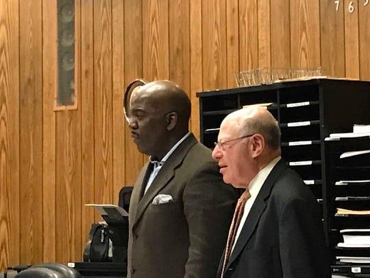 Derrick Chestnut ( L ), with his attorney, John Weichsel, on Thursday.