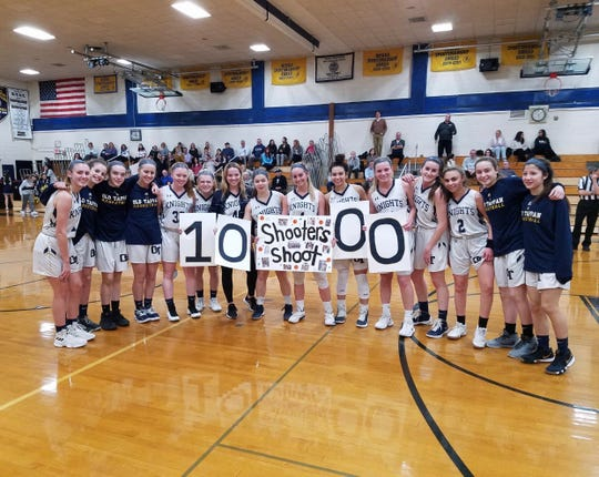 NV/Old Tappan girls basketball players congratulate senior guard Jackie Kelly (center) on reaching 1,000 career points in a 58-34 win over Indian Hills on Tuesday, Jan. 22, 2019. Kelly scored 20 in the game to raise her varsity point total to 1,007.