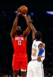 Jan 23, 2019; New York, NY, USA; Houston Rockets guard James Harden (13) shoots over New York Knicks forward Noah Vonleh (32) during the first half at Madison Square Garden.