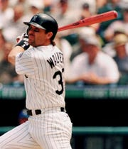 Colorado Rockies' Larry Walker watches the flight of his three-run homer on a pitch from Florida Marlins starting pitcher Ryan Dempster in the first inning of the Rockies' 8-7 victory in Sunday, June 20, 1999 in Denver's Coors Field.