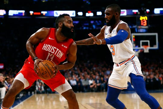 Jan 23, 2019; New York, NY, USA; New York Knicks guard Tim Hardaway Jr. (3) defends against Houston Rockets guard James Harden (13) during the first half at Madison Square Garden.