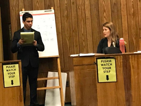 Assistant Prosecutor Jonathan Barrera ( L ) questioning Dolores Coniglio-Rivera, a forensic scientist with the NJ State Police on Thursday.