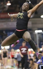 Isabelle Dely, of Paramus Catholic, leaps more than 17 feet in the long jump. Wednesday, January 23, 2019