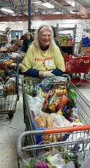 Irene Schultz, an 11-year volunteer with Casa de Peregrinos, helps to prepare baskets of food for distribution to federal workers during a special event Thursday, Jan. 24, 2019 at the organization's headquarters, 999 W. Amador Ave., Ste. F, in Las Cruces.