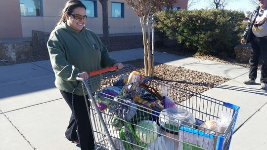 Magaly Carriere of Las Cruces pushes a cart of groceries on Thursday, Jan. 24, 2019 in front of Casa de Peregrinos emergency food bank, 999 W. Amador Ave., Las Cruces. Carriere's husband works for the Border Patrol and is affected by an ongoing partial shutdown. She said she was grateful for assistance to federal employees from local businesses and agencies, such as the food bank.