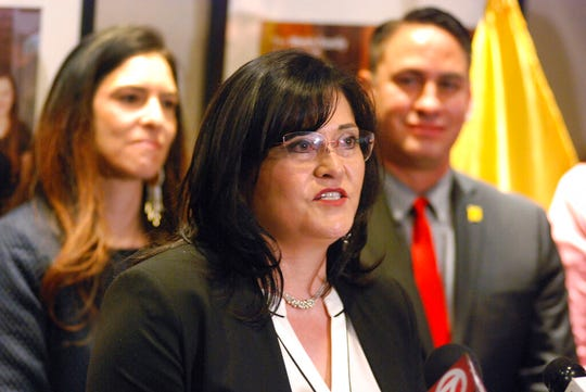 Karen Trujillo, of Las Cruces, is announced as the new as the new Public Education Department secretary at a news conference in Santa Fe on Thursday. In November, Trujillo was elected to the Doña Ana County Commission and earlier this month she was named commission chair. Gov. Michelle Lujan Grisham will be appointing Trujillo's replacement to the board.