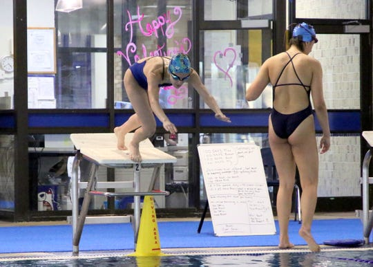 Carlsbad sophomore Emily Dostol dives off the starting blocks swims during a practice session at Carlsbad's Natatorium.