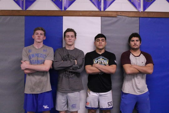 """The four members of Carlsbad's """"Death Row"""". Left to right: Mason Box, Justin Wood, Fabian Padilla and RJ Baca. These four Cavemen wrestle back-to-back-to-back-to-back in Carlsbad's lineup from 150 pounds (Box) to 182 pounds (Baca). As of Jan. 25, 2019, they have a combined 96-12 record."""