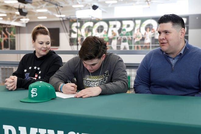 Farmington's Marcus Maldonado signs his national letter of intent on Thursday to continue his baseball career at Northeastern Junior College in Sterling, Colo.