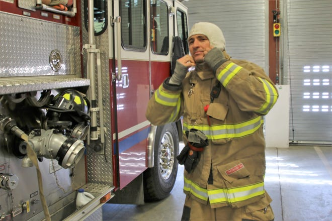Farmington firefighter Marc Ripperger puts on his bunker gear during a demonstration Thursday at Farmington Fire Station One. The Farmington Fire Department has received a grant of nearly $25,000 for new equipment.