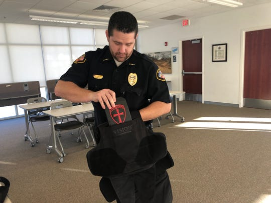 Lt. Randon Matthews of the Bloomfield Police Department displays a bulletproof vest Thursday similar to the 25 vests the department will purchase with a grant of nearly $25,000.