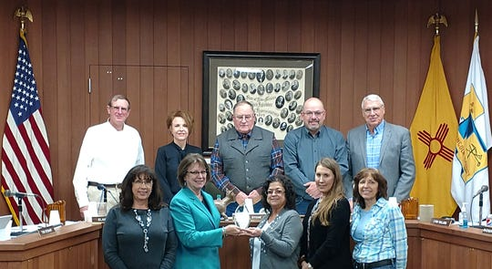 Lincoln County received an Audit & Accountability Award at the New Mexico Counties Legislative Conference Jan. 18  in  Santa Fe. State Auditor Brian Colon presented the award to County Manager Nita Taylor, Commissioner Lynn Willard, Treasurer Beverly Calaway,  Finance Director Punkin Schlarb and Chief Deputy Treasurer Sherrie Huddleston. They showed off the award at Tuesday's county commission meeting. From left in front are Huddleston,  Calaway,  Schlarb,  Rhonda Edwards-Payroll and Toni Foligno-Assets/Inventory In back from left are Commission members Tom Stewart,  Elaine Allen,  Chairman Preston Stone,  Dallas Draper and Willard.