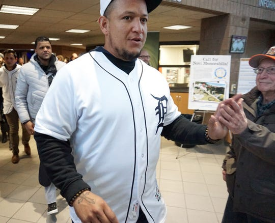 Novi resident Fred Geist gets a high-five from Tigers' slugger Miguel Cabrera as the team leaves the auditorium after their Winter Caravan visit.