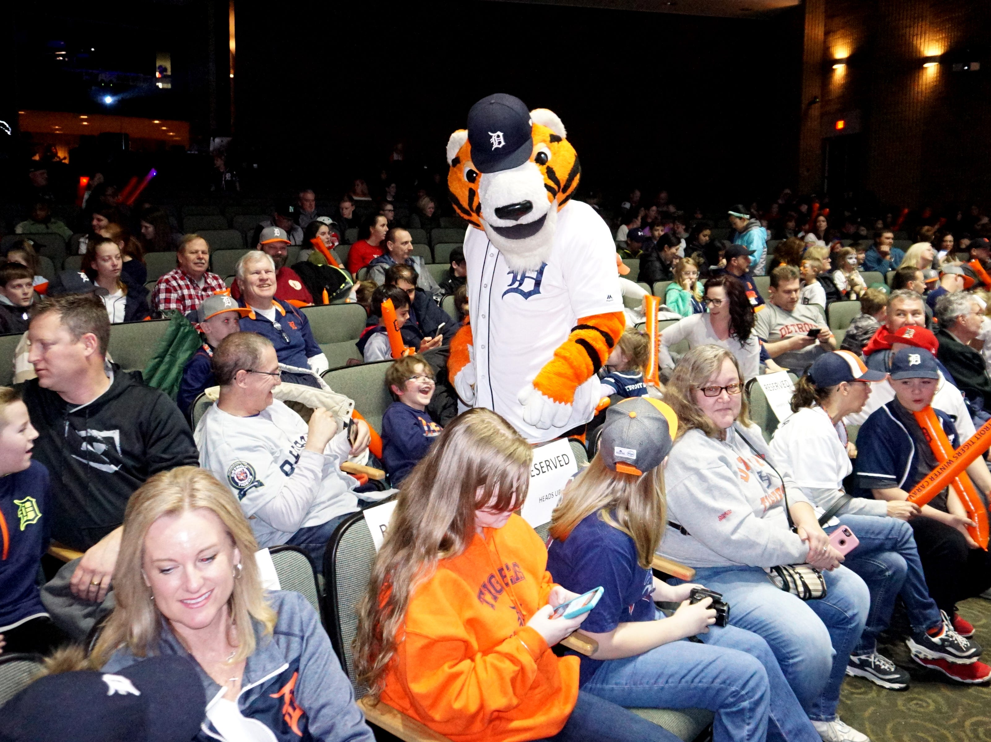 Paws prowls the aisles of Novi High's auditorium on Thursday before the Tigers visited for another meeting with their fans in town.