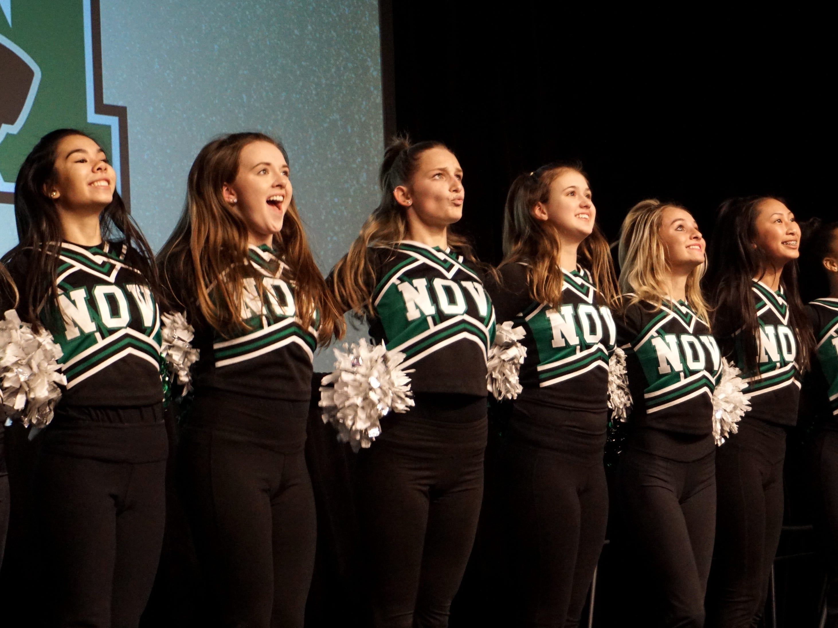 The Novi High School varsity pom-pon team performs a quick routine before the Tigers' visit to the Civic Center.