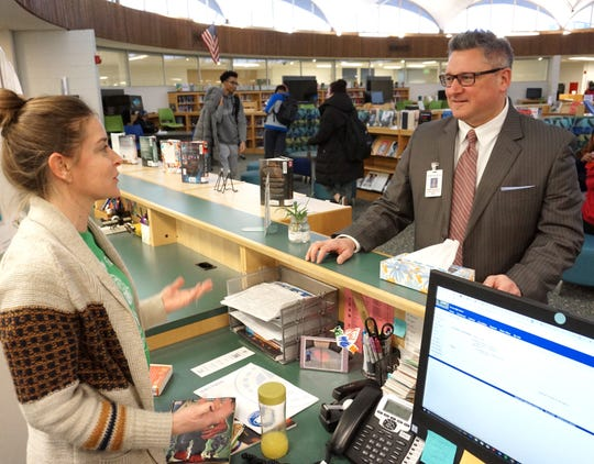 BPS Superintendent Mark Dziatczak talks to Groves High librarian Sharla Lawshea during a Jan. 24 visit to the school.