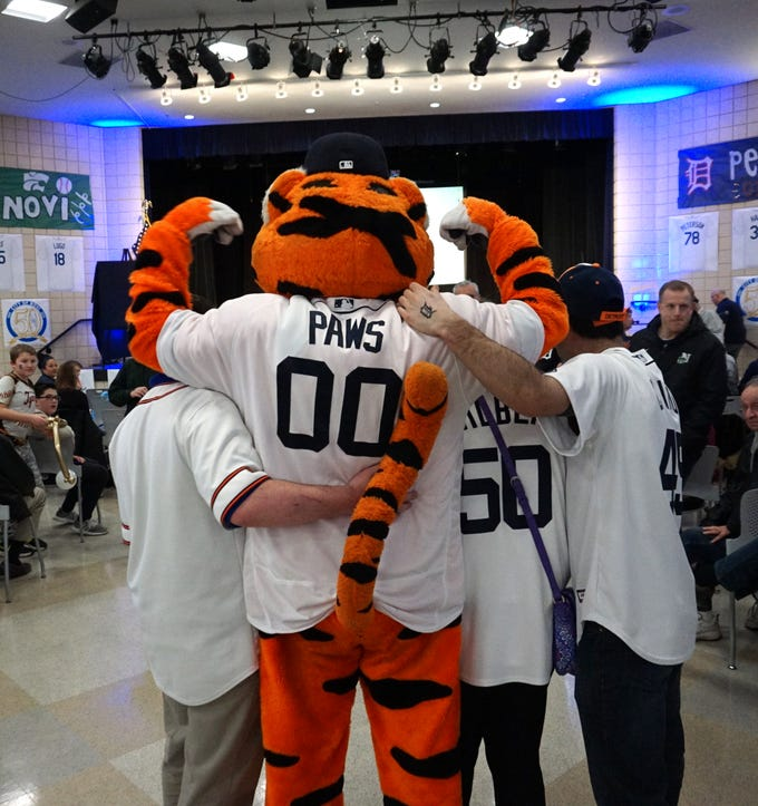 The Detroit Tigers' Paws pauses for a photo with some fans at the Novi Civic Center on Jan. 24 during a stop their by the team's winter caravan.