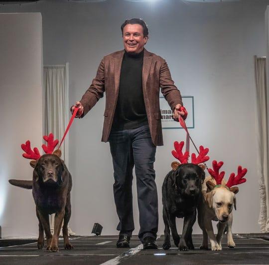 """Garry Kief and his pack of """"reindeers"""" on the runway"""