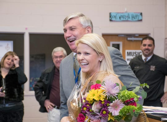 Caroline Buechner, right, is all smiles after being informed by Superintendent Tim Wyrosdick that she is the Santa Rosa County District Schools' Teacher of the Year at Navarre High School on Thursday, January 24, 2019.
