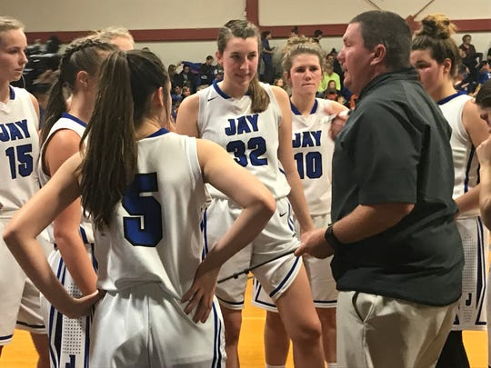 Jay's Madison Mathis (No. 32) listens to head coach Brian Watson during a timeout on Jan. 17 against Northview.