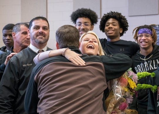 Santa Rosa County District Schools' Teacher of the Year Caroline Buechner gets a hug from dean of students Klint Lay at Navarre High School on Thursday, January 24, 2019.