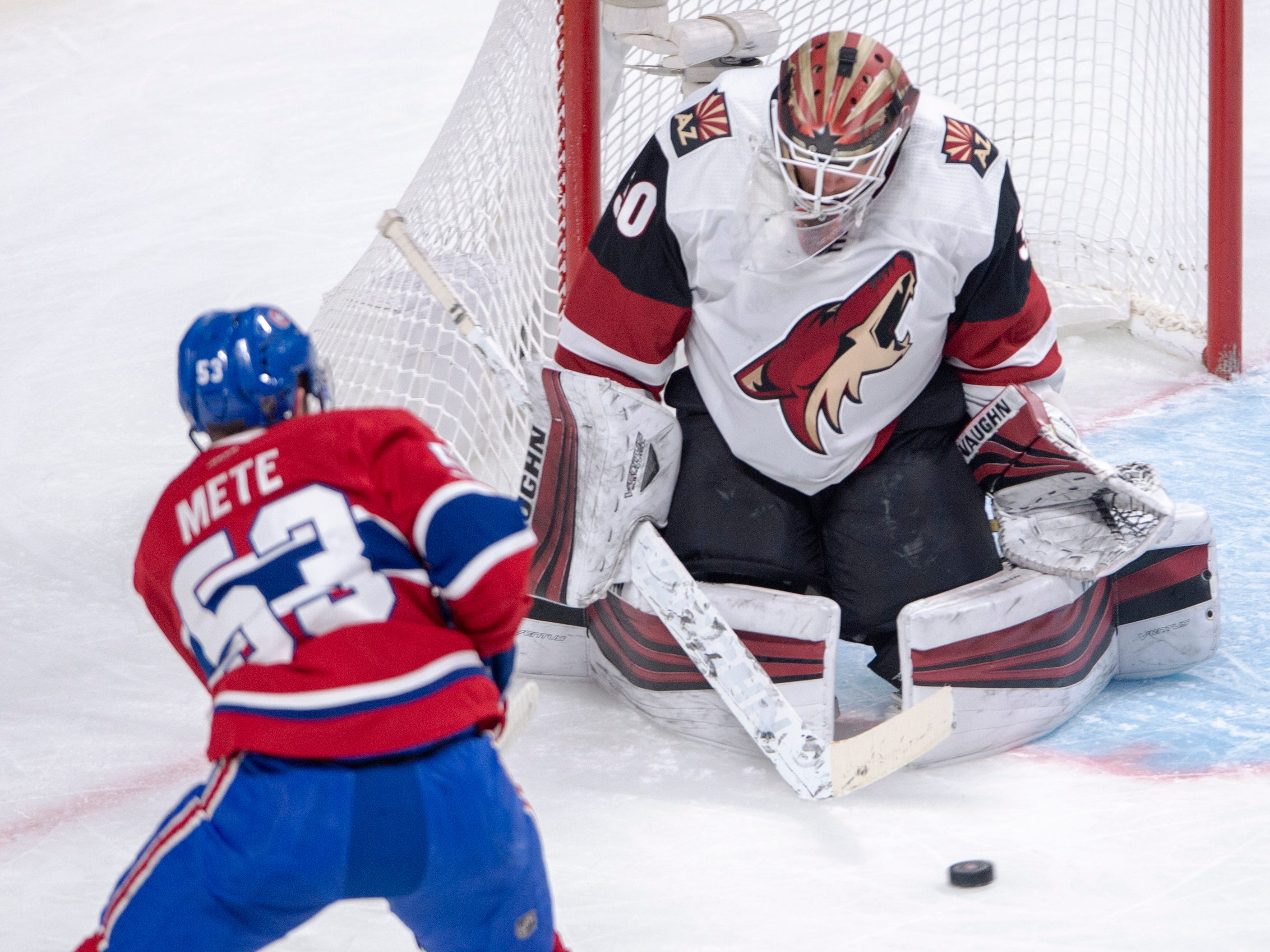 Arizona Coyotes goaltender Calvin Pickard (30) stops Montreal Canadiens defenceman Victor Mete (53) during the first period of an NHL hockey game Wednesday, Jan. 23, 2019, in Montreal.