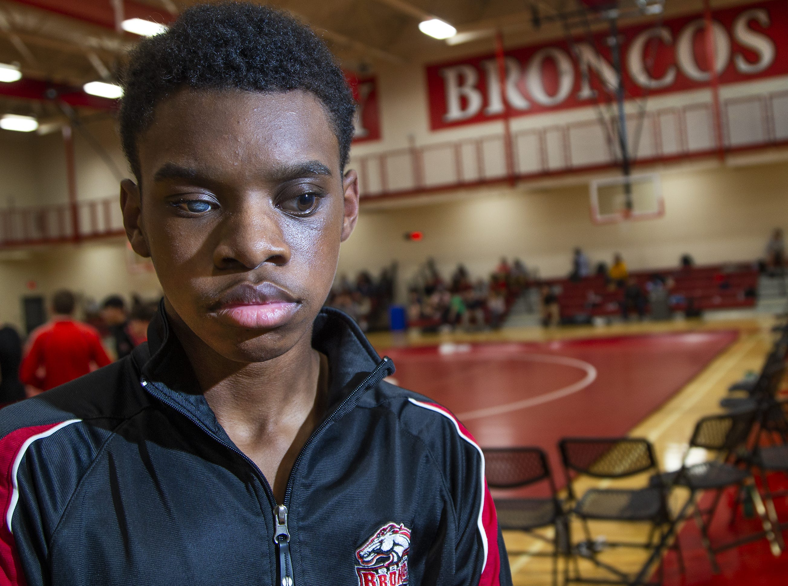 Adonis Watt is a blind wrestler for Brophy College Preparatory high school in Phoenix.  He wait for his match at Brophy, Wednesday, January 23, 2019.