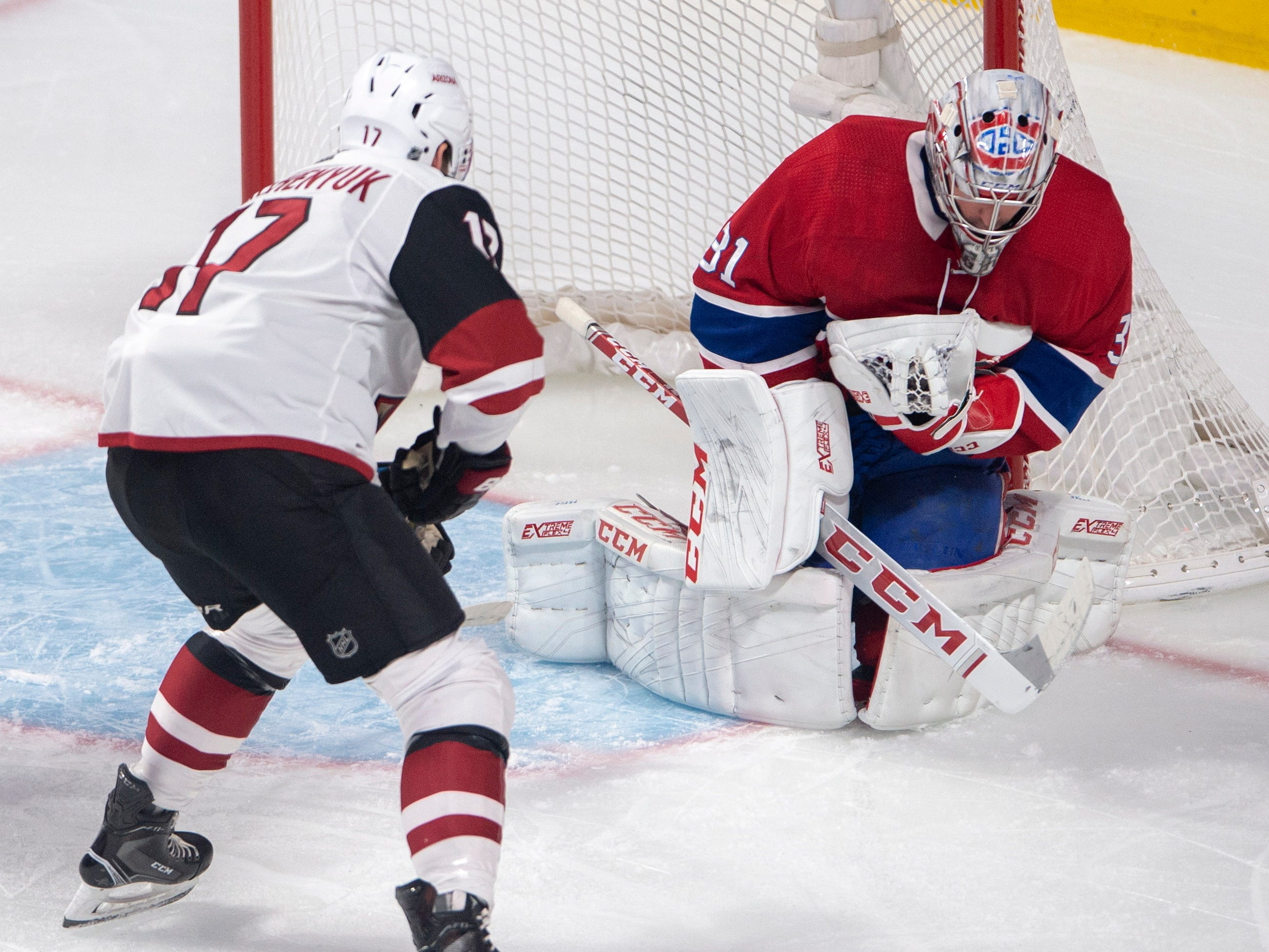 Montreal Canadiens goaltender Carey Price (31) stops Arizona Coyotes center Alex Galchenyuk (17) during the first period of an NHL hockey game Wednesday, Jan. 23, 2019, in Montreal. (Ryan Remiorz/The Canadian Press via AP)