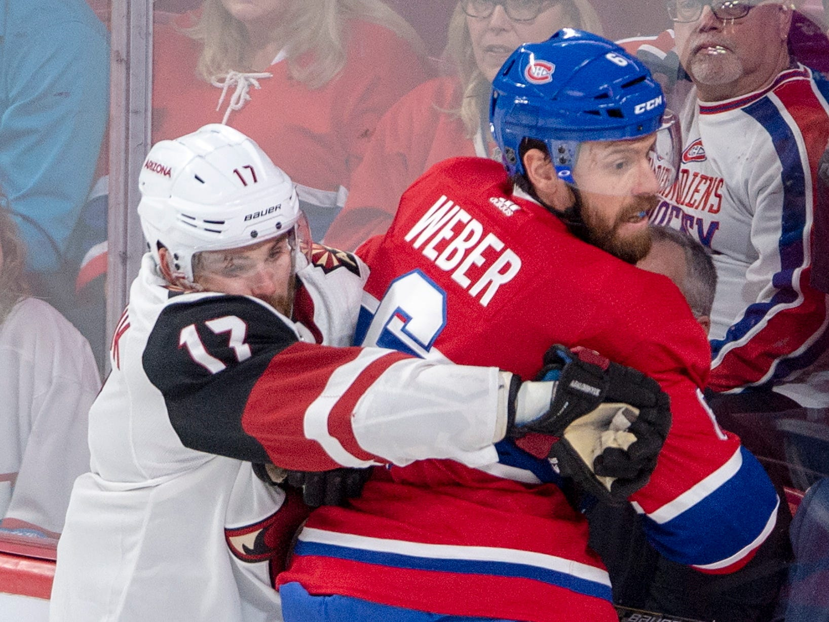 Arizona Coyotes center Alex Galchenyuk (17) checks Montreal Canadiens defenseman Shea Weber (6) into the boards during the first period of an NHL hockey game Wednesday, Jan. 23, 2019, in Montreal.