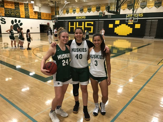 Jan. 23, 2019; Scottsdale Horizon girls basketball seniors Jacey Carter (left), Alyssa Alvarez (middle) and Madison Cabardo (right) at practice.