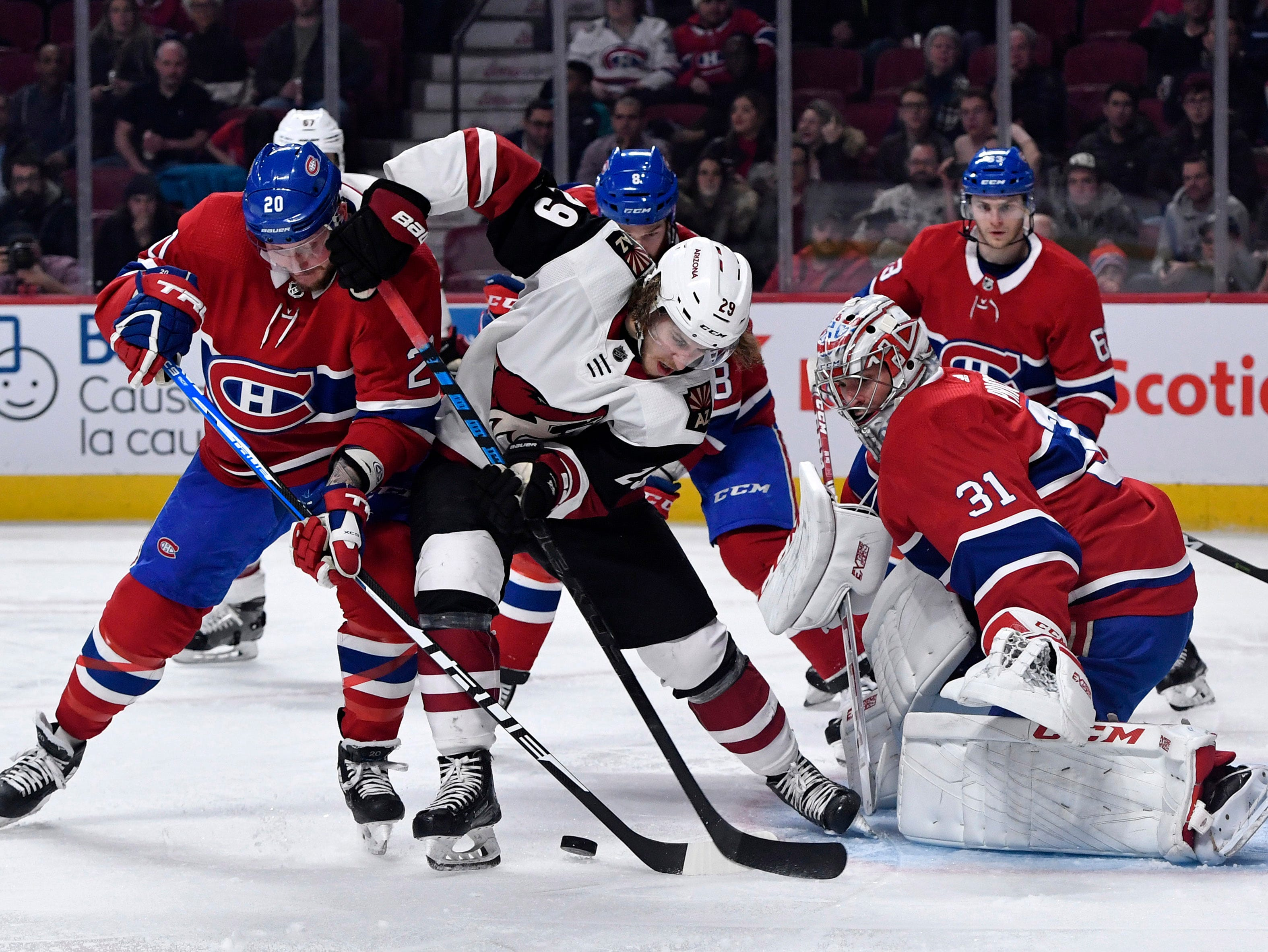 Jan 23, 2019; Montreal, Quebec, CAN; Arizona Coyotes forward Mario Kempe (29) attempts to control the puck as Montreal Canadiens goalie Carey Price (31) and Canadiens forward Nicolas Deslauriers (20) defend during the second period at the Bell Centre. Mandatory Credit: Eric Bolte-USA TODAY Sports