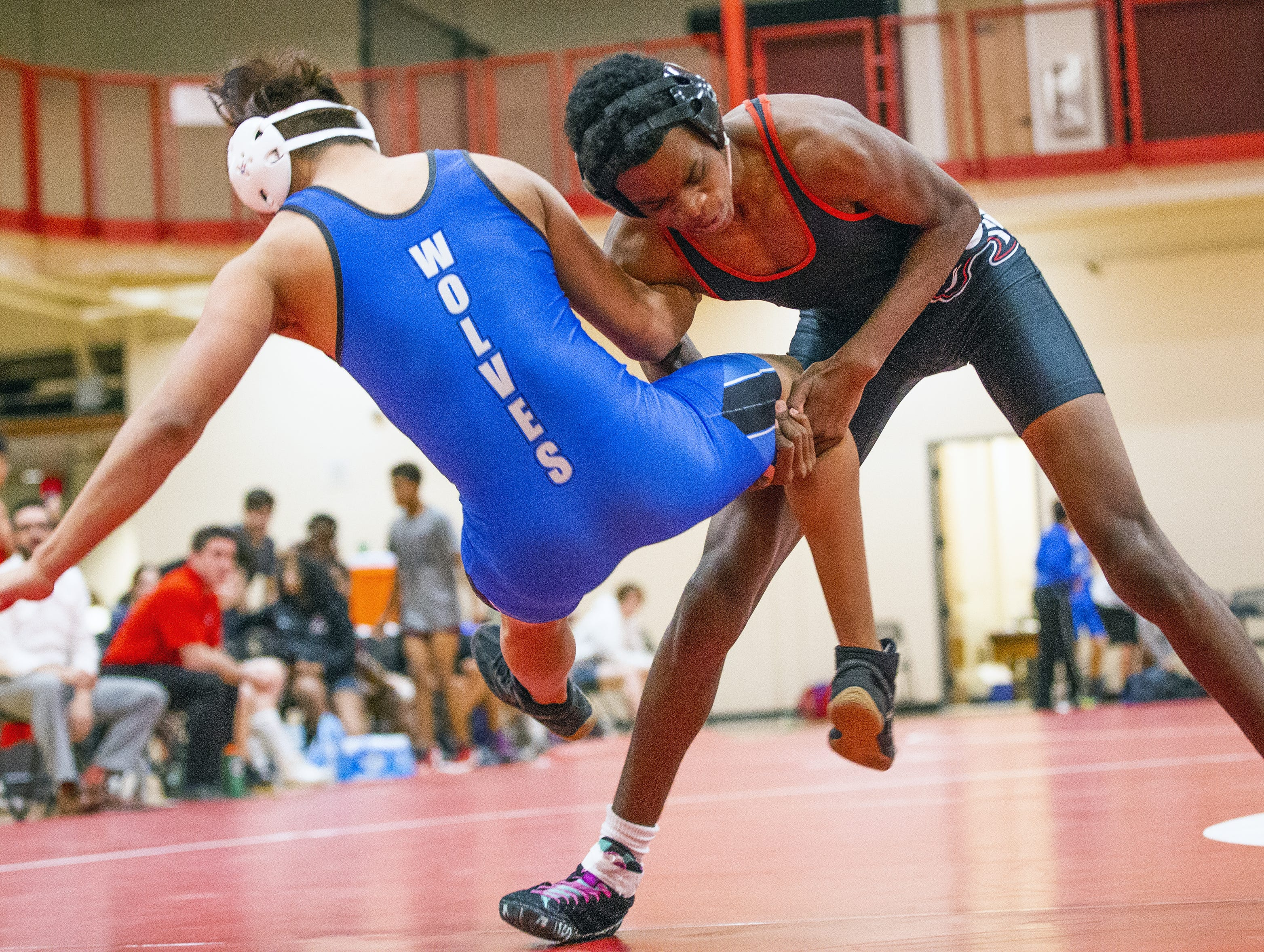 Adonis Watt is a blind wrestler for Brophy College Preparatory high school in Phoenix.  He takes on Chandler High School wrestler Kevin Rodriguez in the 152 lb. class at Brophy, Wednesday, January 23, 2019.  Watt won with a pin in the third period.