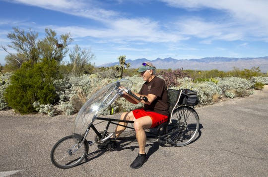 John Susong, from Akron, Ohio,  rides his bike in Saguaro National Park near Tucson on January 16. The park remains open during the federal shutdown.