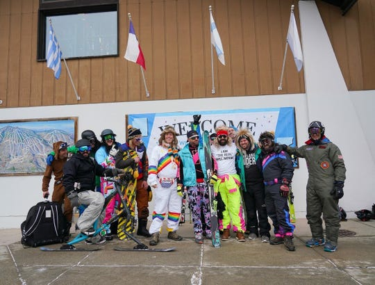 Will Novak of Phoenix stands with the other gentlemen of #AngelosBachelorParty at Okemo Mountain Resort in Ludlow, Vermont, on Jan. 19, 2019.